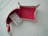 Travel tray poppered up and ready for use with jewellery purse. Hang your earrings on the netting to keep them secure.