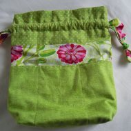 Flat view of drawstring bag with outside pockets